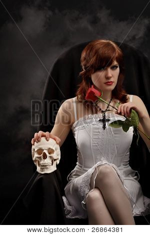 Young Sexy Witch With A Skull And Rose
