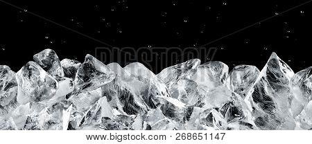 Ice Blocks Against Black Background With Water Drops