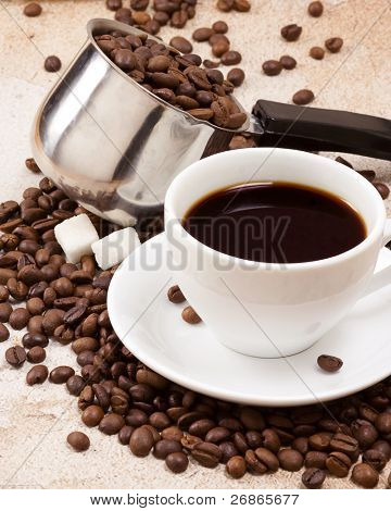 coffee pot, cup and sugar on texture