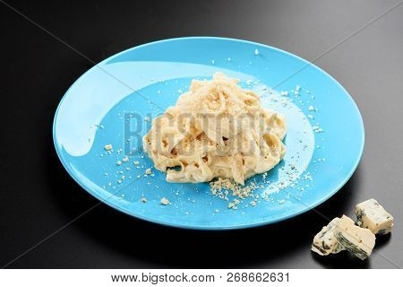 Plate Of Italian Penne Pasta With A Formaggio Creamy Savory Sauce And Basil Served In A Blue Dish Bl