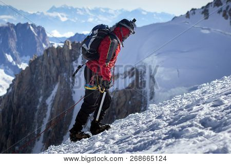 Climber Reaches The Summit Of Mountain Peak. Success, Freedom And Happiness, Achievement In Mountain
