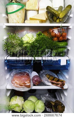 Refrigerator Inside Full Of Assorted Food Ingredients, Vegetables, Meat And Dairy Products
