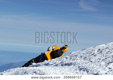 Climber Fell And Lies In The Snow. Is Sick
