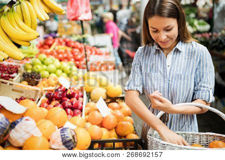 Beautiful Happy Young Women Shopping Vegetables And Fruits