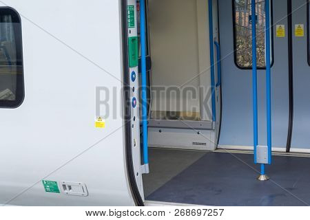 Open Door Of A Train With No People In Carriage