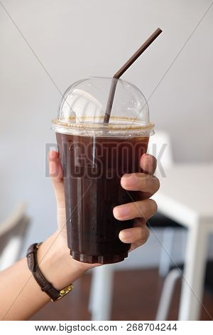 Iced Americano Black Coffee In Girl Hand. Take Away Drink Concept