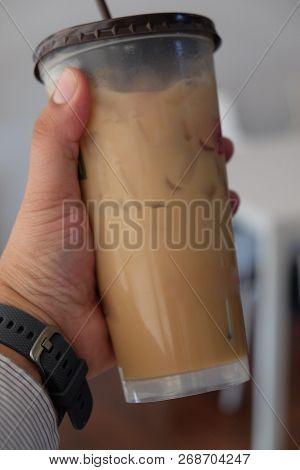 Keeping In Hands Iced Coffee, Summer Beverage Concept