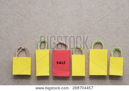 Red Shopping Bag From Recycle Paper. Special Offer Shopping Time Concept. Copy Space
