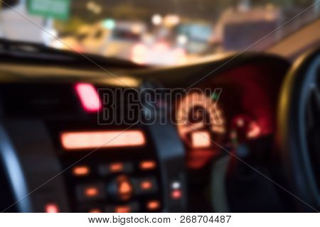 Driving At Night. Blurred Cars In City With City Traffic On Town Streets.