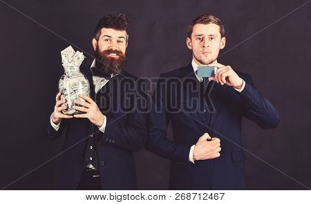 Credit Card Concept. Men In Suit, Businessmen With Jar Full Of Cash And Credit Card, Black Backgroun