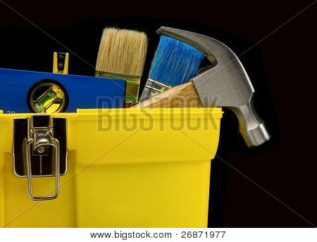 set of tools in toolbox isolated on black background