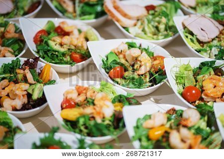 Snack Of Shrimp, Avocado And Greens On Plates For Guests Of The Event. Catering And Snacks For Guest