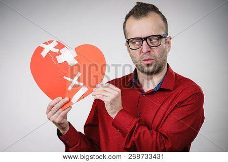 Bad Relationships, Breaking Up, Sadness Emotions Concept. Sad Adult Man Holding Broken Heart, On Gre