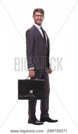 full growth. confident businessman with leather briefcase