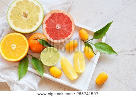Set Of Citrus On Light Background: Orange, Mandarin, Lemon, Grapefruit, Lime, Kumquat, Tangerine. Fr