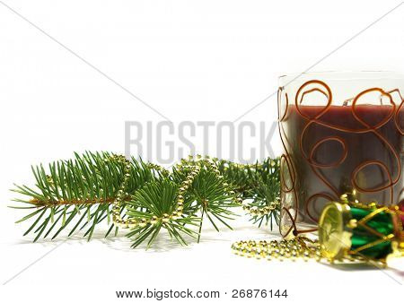 Christmas card. Candle and decoration isolated on white