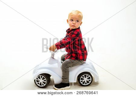 Simply Just Twist And Go. Boy Child On Riding Toy. Little Child Ride On Toy Car. Little Baby Enjoy P