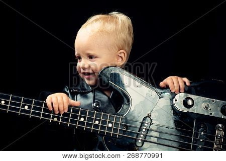 Enjoy Live Music. Little Guitarist In Rocker Jacket. Little Rock Star. Child Boy With Guitar. Rock S
