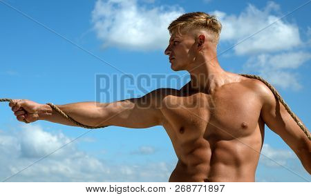 A Man Of Ambition. Strong Man Pull Rope. Sport Man Develop Muscular Hand Strength. Athlete With Fit