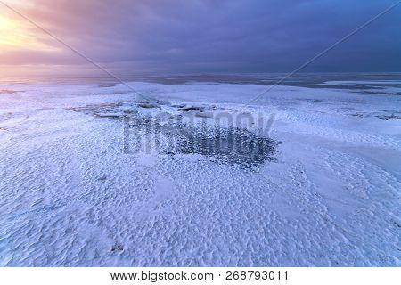 Dark Ice Dawn On The Frozen Lake / A Dull Morning Gave A Soft Dawn