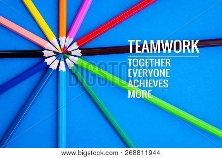 Teamwork Concept. Group Of Color Pencil On Blue Background With Word Teamwork, Together, Everyone, A