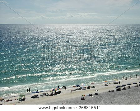 Sunshine On The Waters Of The Gulf Of Mexico Creates Shimmering, Silvery Ripples As Far As The Eye C