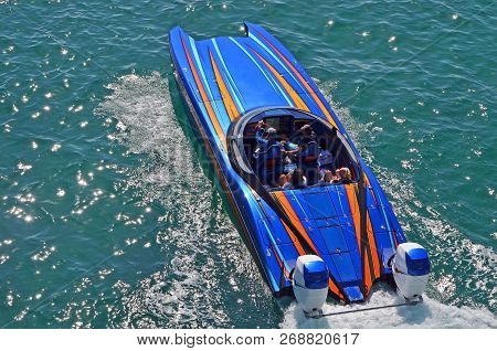 Overhead View A Blue Speed Boat With Orange Trim Powered By Two Outboard Engines Cruising On The Flo
