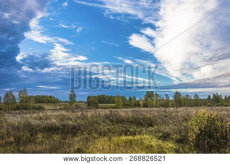Beautiful Autumn Landscape With Fields, Forests And Cloudy Sky.