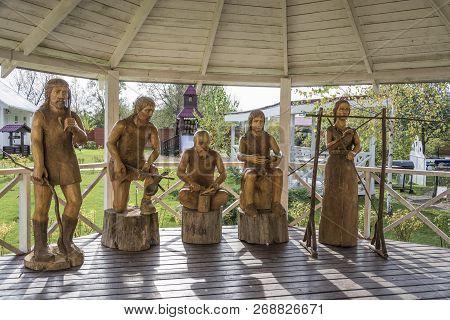 Vyatkoye Village, Yaroslavl Region, Russia - 10/02/2018: Primitive Sculptures Of Primitive People On