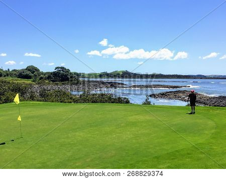 Waitangi, North Island, New Zealand - February 19th, 2016: A Man Lining Up A Putt While Golfing In W