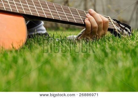 loseup of a boys hand with a guitar