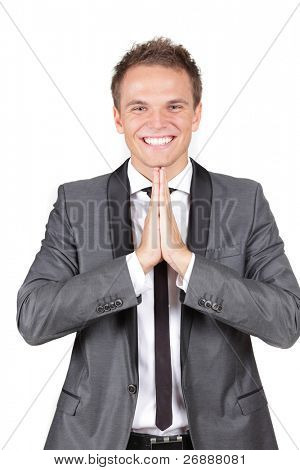 A young caucasian businessman expressing his gratitude in prayer