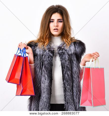 Woman Shopping Luxury Boutique. Lady Hold Shopping Bags In Hands. Shopping Concept. Fashionista Buy