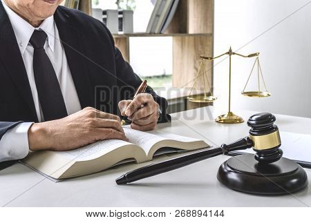 Law, Lawyer Attorney And Justice Concept, Male Lawyer Or Notary Working On A Documents And Report Of