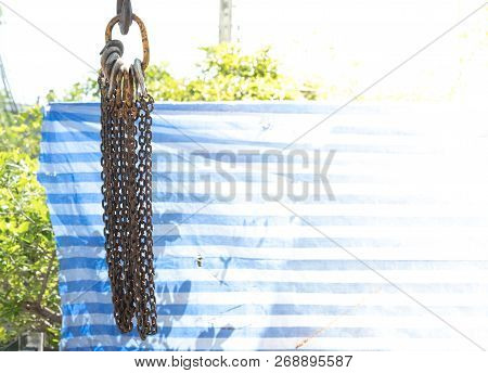 Chain With Winch Hooked On The Construction Crane Hook