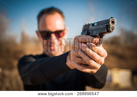 Police Agent And Bodyguard Pointing Pistol To Protect From Attacker. Gun Point Aiming Front View Out