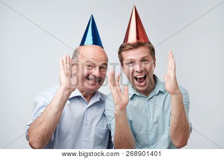 Mature Father And Son Celebrating Birthday Or Other Family Holiday.