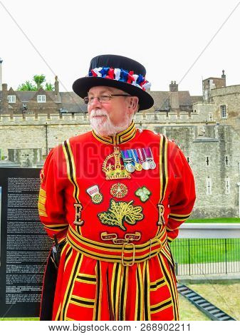 London, United Kingdom - June 10, 2013: Beefeater Near Walls Of The Tower Of London. Beefeaters Or Y