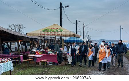 Hecha, Ukraine - Jan 27, 2018: Pork Butchers Competition. Early Preparation And Discussions Before T