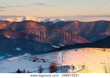 Winter Countryside Of Carpathian Mountains. Beautiful Landscape At Sunrise. Rural Fields On A Hill C