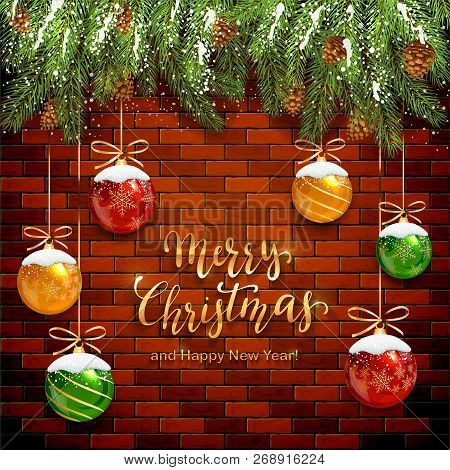 Fir Tree Branches On Brick Wall Background And Christmas Balls With Snow. Golden Lettering Merry Chr