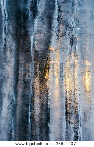 Beautiful Ice Texture Lit From Behind. Ice And Sun, Cold And Warm, Winter And Spring Resistance Conc
