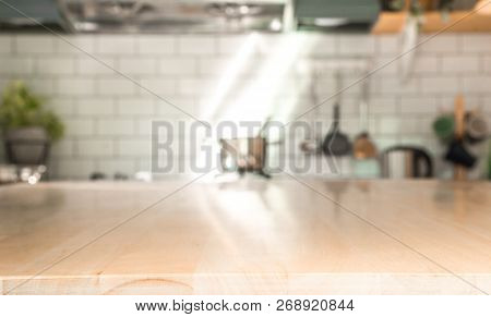 Kitchen Room And Background Concept - Blurred Light Brown Wooden Table With Beautiful Modern Vintage