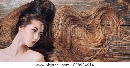 Natural girl with long healthy hair. Longhair and hairstyle concept. Hair salon concept. Brunette girl with long and shiny wavy hair poster
