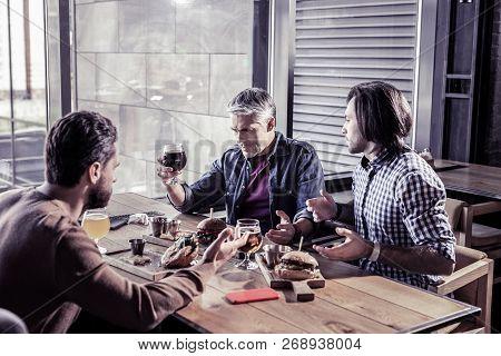 Serious Senior Man Staring At Beer Bocal