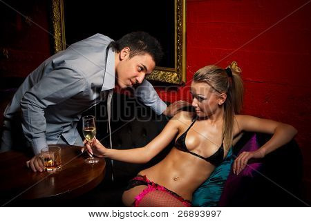 Drunk guy  flirting with stripteaser girl in night club poster