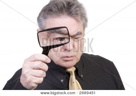 Mature Man With Magnifying Glass