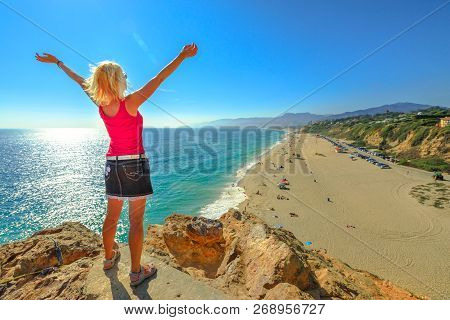Caucasian Female Looking Point Dume State Beach From Point Dume Promontory On Malibu Coast In Ca, Un