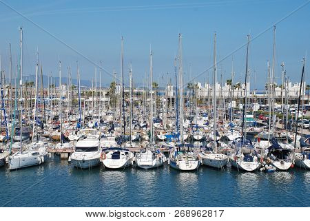 BARCELONA, SPAIN - APRIL 17, 2018: Boats moored in the marina at Port Olimpic. The area was re-developed for the 1992 Olympic games.