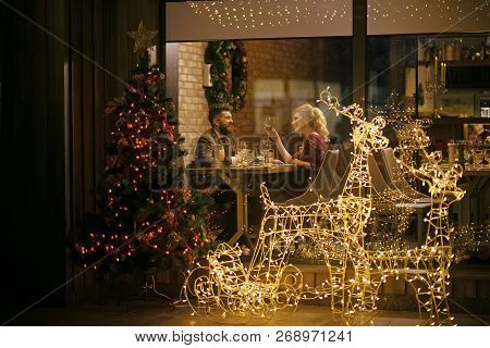 Happy Family Celebrate New Year And Christmas. Couple In Love Enjoy Xmas Cuisine, Food, Wine. Woman